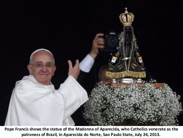 Pope Francis shows the statue of the Madonna of Aparecida, who Catholics venerate as the patroness of Brazil, in Aparecida...