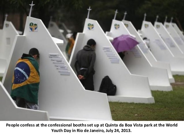 People confess at the confessional booths set up at Quinta da Boa Vista park at the World Youth Day in Rio de Janeiro, Jul...