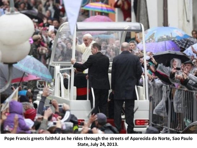Pope Francis greets faithful as he rides through the streets of Aparecida do Norte, Sao Paulo State, July 24, 2013.