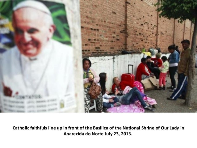 Catholic faithfuls line up in front of the Basilica of the National Shrine of Our Lady in Aparecida do Norte July 23, 2013.