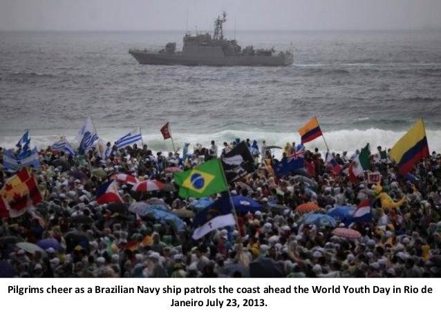 Pilgrims cheer as a Brazilian Navy ship patrols the coast ahead the World Youth Day in Rio de Janeiro July 23, 2013.
