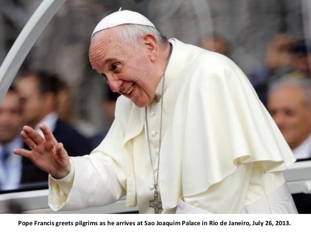 Pope Francis greets pilgrims as he arrives at Sao Joaquim Palace in Rio de Janeiro, July 26, 2013.