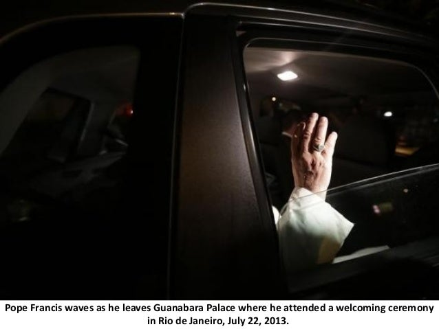 Pope Francis waves as he leaves Guanabara Palace where he attended a welcoming ceremony in Rio de Janeiro, July 22, 2013.