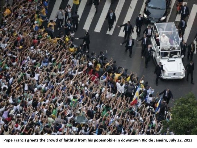 Pope Francis greets the crowd of faithful from his popemobile in downtown Rio de Janeiro, July 22, 2013