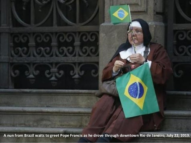 A nun from Brazil waits to greet Pope Francis as he drove through downtown Rio de Janeiro, July 22, 2013.
