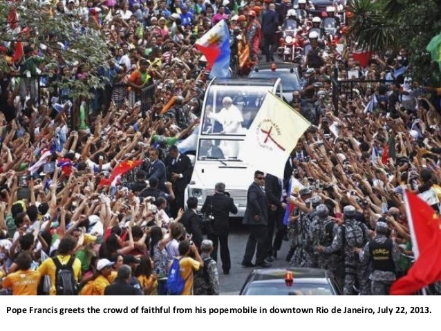 Pope Francis greets the crowd of faithful from his popemobile in downtown Rio de Janeiro, July 22, 2013.