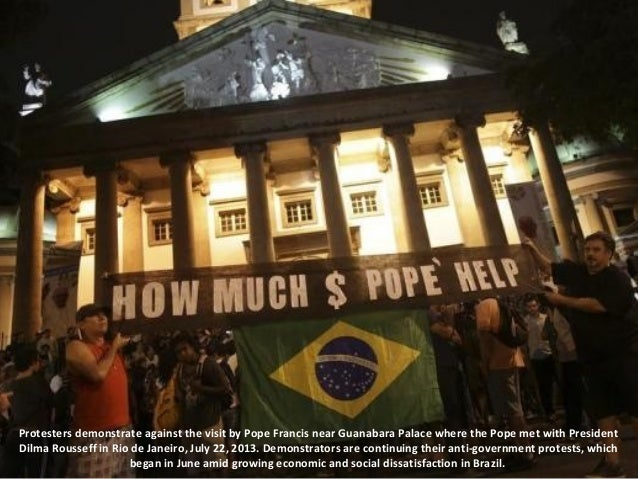 Protesters demonstrate against the visit by Pope Francis near Guanabara Palace where the Pope met with President Dilma Rou...