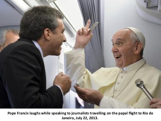 Pope Francis laughs while speaking to journalists travelling on the papal flight to Rio de Janeiro, July 22, 2013.