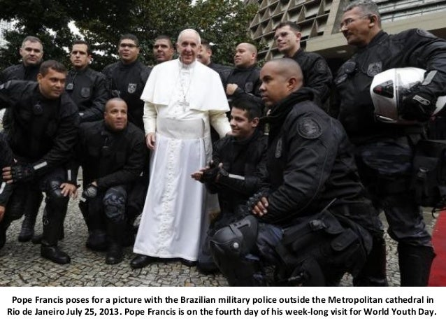 Pope Francis poses for a picture with the Brazilian military police outside the Metropolitan cathedral in Rio de Janeiro J...
