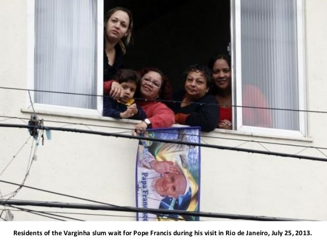 Residents of the Varginha slum wait for Pope Francis during his visit in Rio de Janeiro, July 25, 2013.