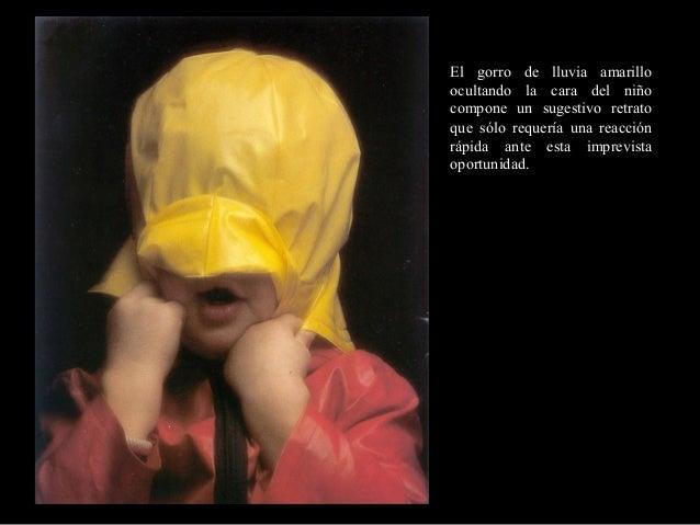 El gorro de lluvia amarilloocultando la cara del niñocompone un sugestivo retratoque sólo requería una reacciónrápida ante...