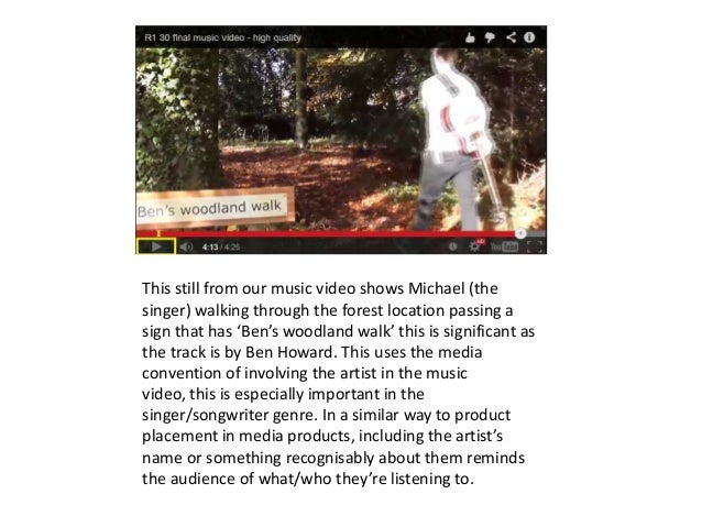 This still from our music video shows Michael (the singer) walking through the forest location passing a sign that has 'Be...
