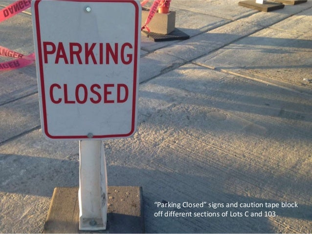 """""""Parking Closed"""" signs and caution tape block off different sections of Lots C and 103."""