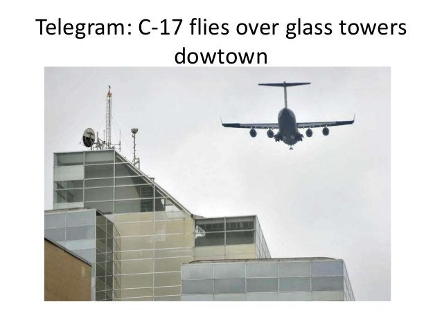 Telegram: C-17 flies over glass towers dowtown