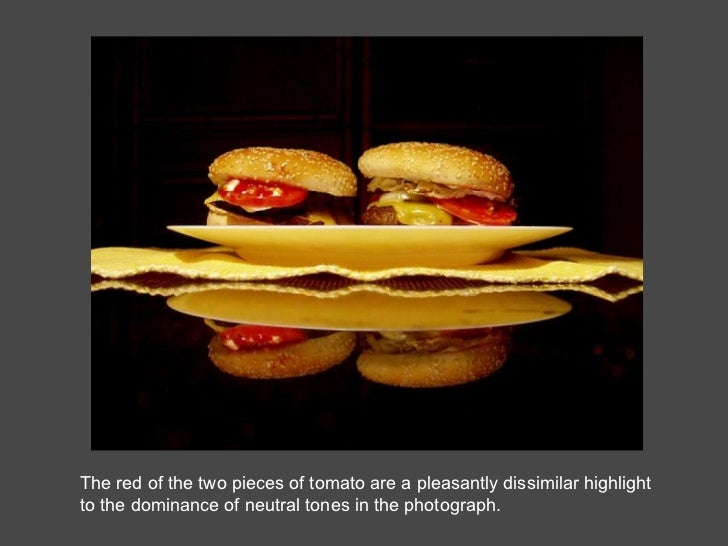 The red of the two pieces of tomato are a pleasantly dissimilar highlight to the dominance of neutral tones in the photogr...