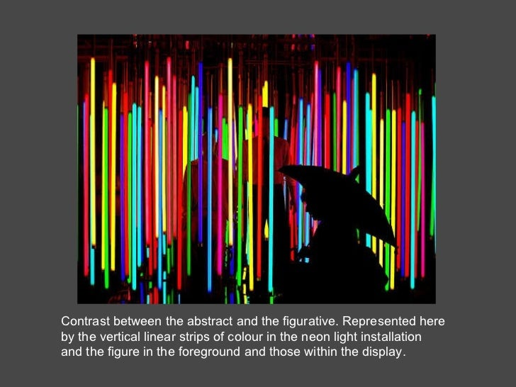 Contrast between the abstract and the figurative. Represented here by the vertical linear strips of colour in the neon lig...