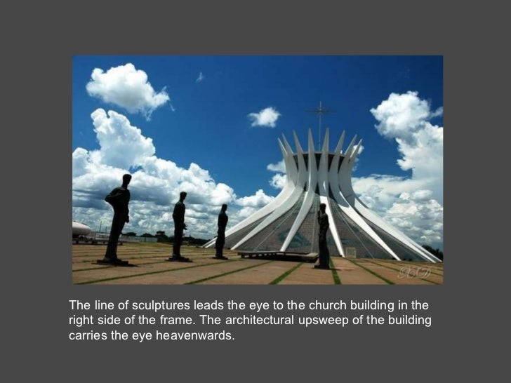 The line of sculptures leads the eye to the church building in the right side of the frame. The architectural upsweep of t...