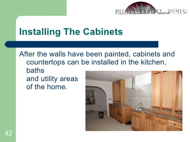Installing The Cabinets <ul><li>After the walls have been painted, cabinets and countertops can be installed in the kitche...