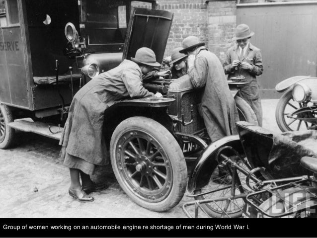 Group of women working on an automobile engine re shortage of men during World War I.