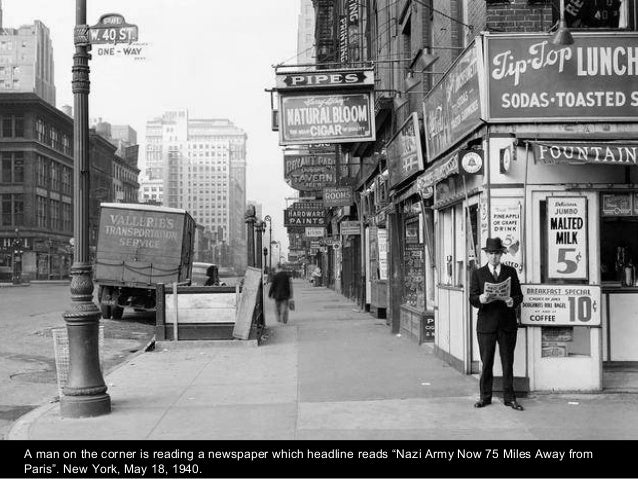 """A man on the corner is reading a newspaper which headline reads """"Nazi Army Now 75 Miles Away from Paris"""". New York, May 18..."""
