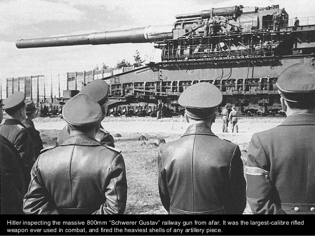 """Hitler inspecting the massive 800mm """"Schwerer Gustav"""" railway gun from afar. It was the largest-calibre rifled weapon ever..."""