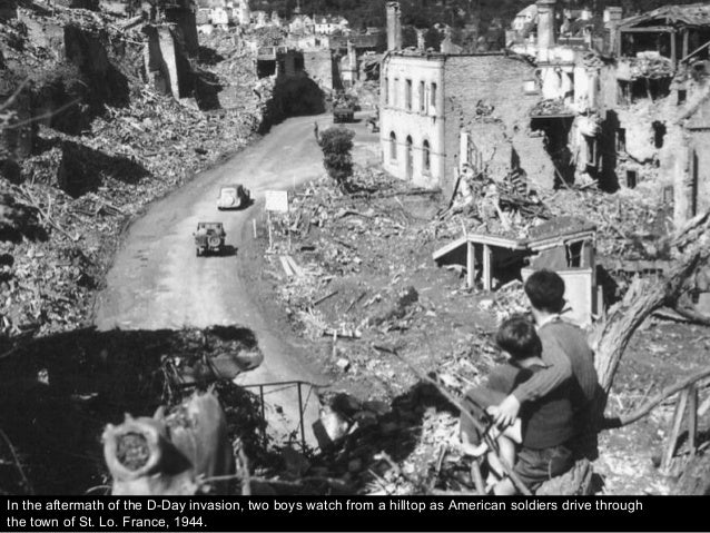 In the aftermath of the D-Day invasion, two boys watch from a hilltop as American soldiers drive through the town of St. L...