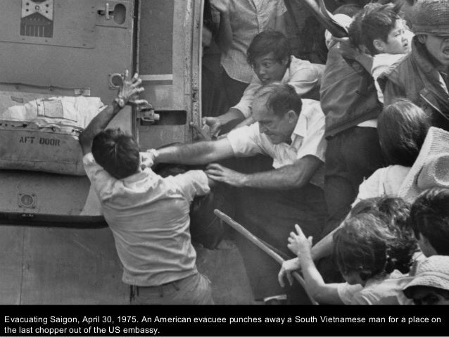 Evacuating Saigon, April 30, 1975. An American evacuee punches away a South Vietnamese man for a place on the last chopper...