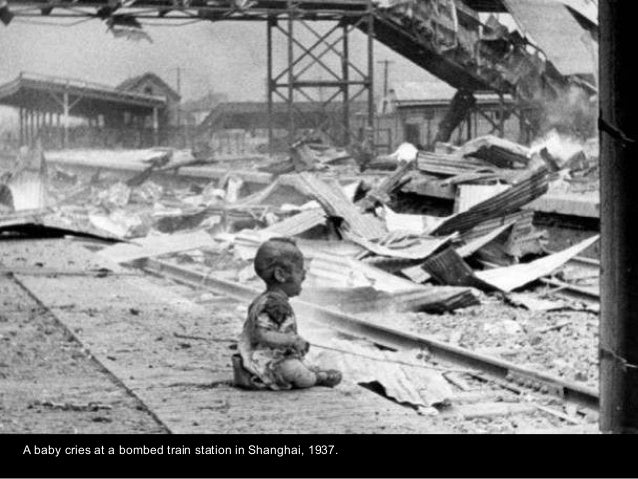 A baby cries at a bombed train station in Shanghai, 1937.