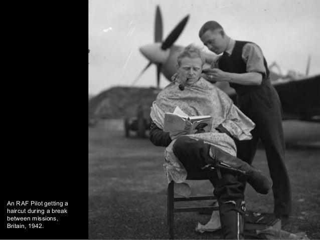 An RAF Pilot getting a haircut during a break between missions, Britain, 1942.