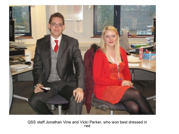 QSS staff Jonathan Vine and Vicki Parker, who won best dressed in red
