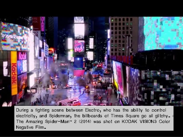 During a fighting scene between Electro, who has the ability to control electricity, and Spiderman, the billboards of Time...