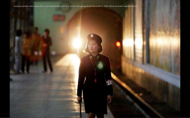 A subway worker walks away after a train departed the station in central Pyongyang, North Korea May 7, 2016. (Photo by Dam...