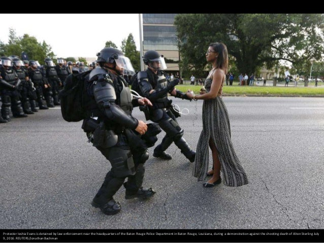 Protester Ieshia Evans is detained by law enforcement near the headquarters of the Baton Rouge Police Department in Baton ...