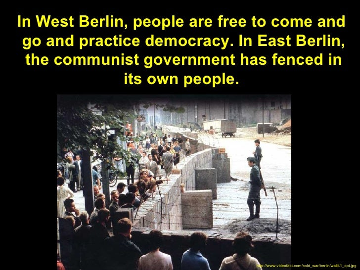 In West Berlin, people are free to come and go and practice democracy. In East Berlin, the communist government has fenced...