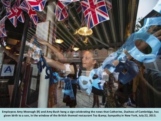 Crowds of people try to look at a notice formally announcing the birth of a son to Prince William and Catherine, Duchess o...