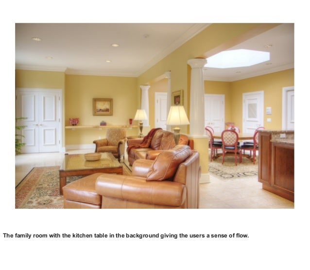The family room with the kitchen table in the background giving the users a sense of flow.