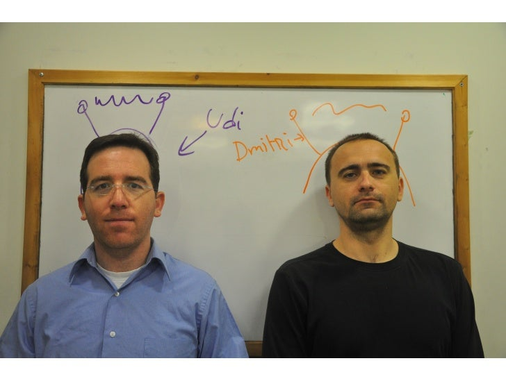 <about us>     Pictures of both, wearing alien helmets drawn on whiteboard behind With names