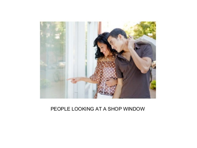 PEOPLE LOOKING AT A SHOP WINDOW