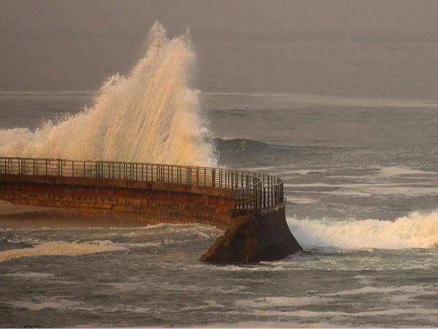 Hard Engineering Measures • Breakwaters (+) • Breakwaters - Protect coast and harbour by reducing force of high energy wav...