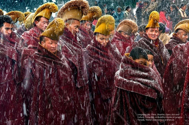 Longxiang Xie, China, Shortlist, Open, Arts and Culture. Snow falls on Buddhist monks at Langmu Temple, Tibetan autonomous...