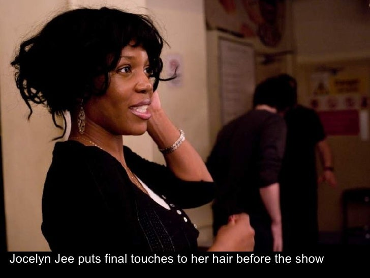 Jocelyn Jee puts final touches to her hair before the show