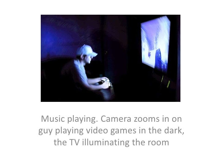 Music playing. Camera zooms in on guy playing video games in the dark, the TV illuminating the room <br />