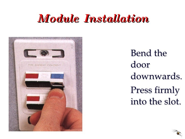Module Installation <ul><li>Bend the door downwards. </li></ul><ul><li>Press firmly into the slot. </li></ul>