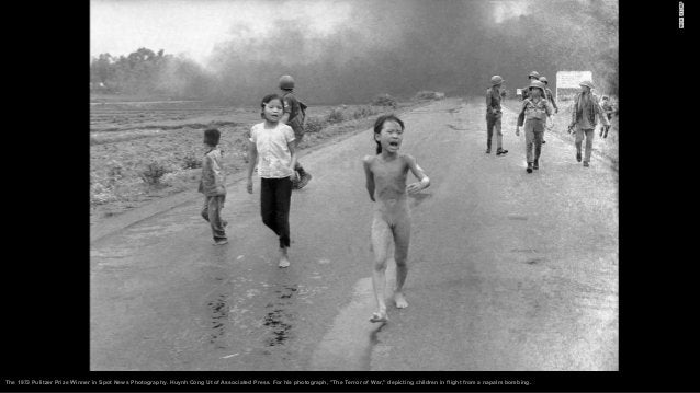 1991: Fiery death in South Africa – A boy runs past a chilling scene. A youth is clubbing the burning body of a man identi...