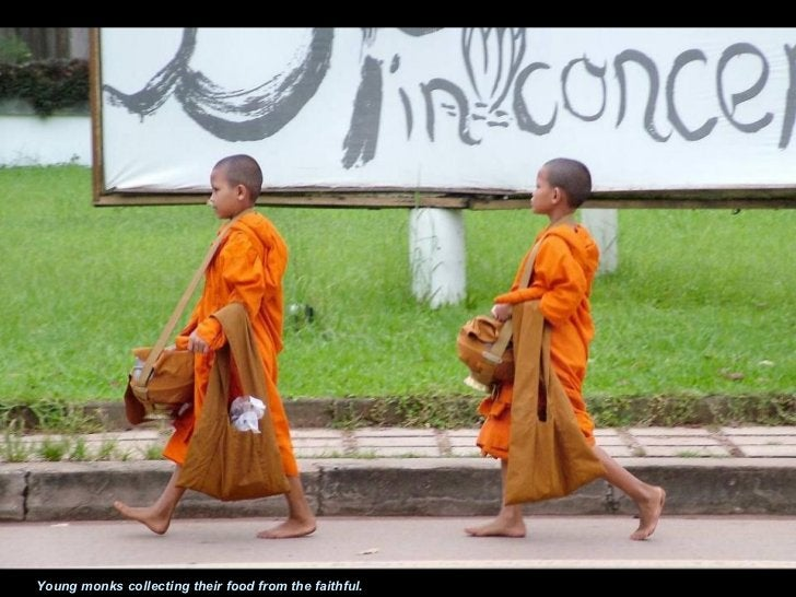 Young monks collecting their food from the faithful.