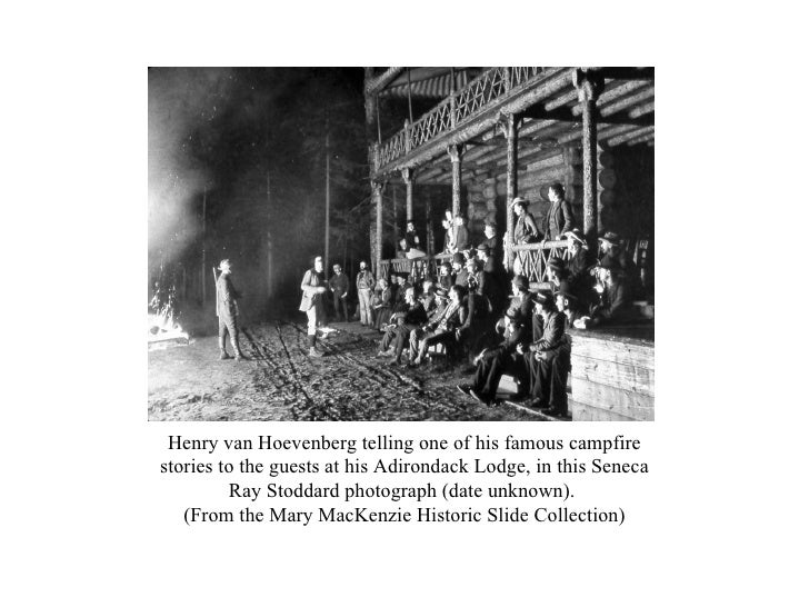 Henry van Hoevenberg telling one of his famous campfire stories to the guests at his Adirondack Lodge, in this Seneca Ray ...