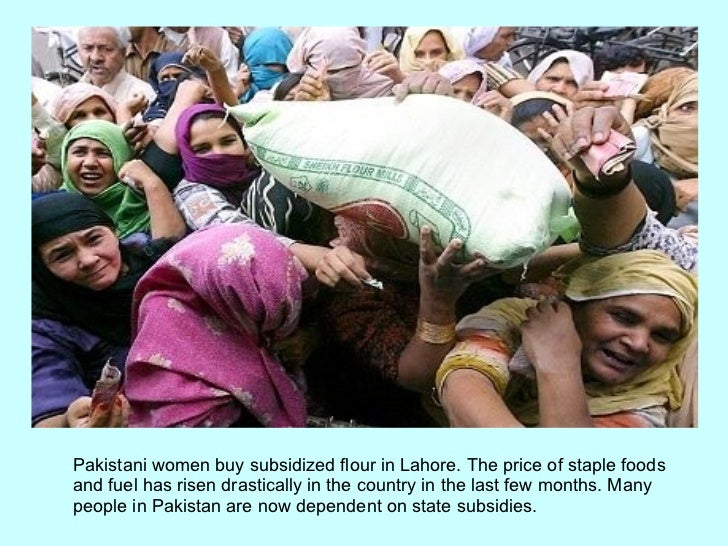 Pakistani women buy subsidized flour in Lahore. The price of staple foods and fuel has risen drastically in the country in...