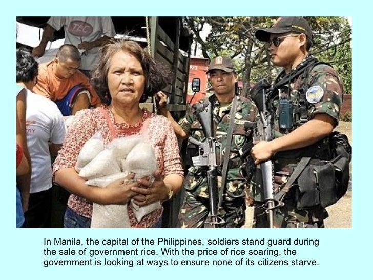 In Manila, the capital of the Philippines, soldiers stand guard during the sale of government rice. With the price of rice...