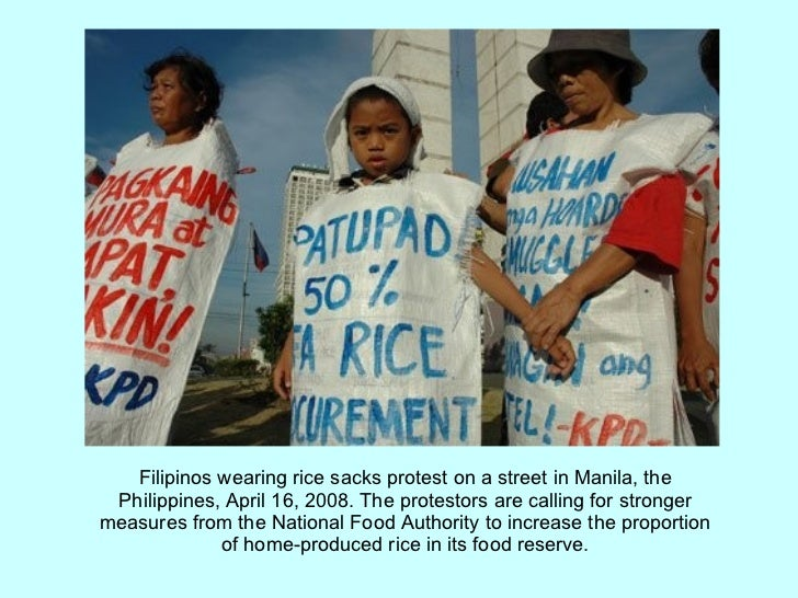 Filipinos wearing rice sacks protest on a street in Manila, the Philippines, April 16, 2008. The protestors are calling fo...