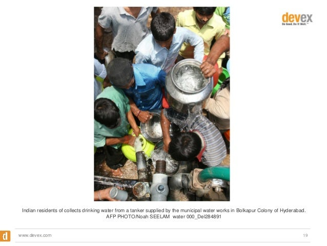 Indian residents of collects drinking water from a tanker supplied by the municipal water works in Bolkapur Colony of Hyde...
